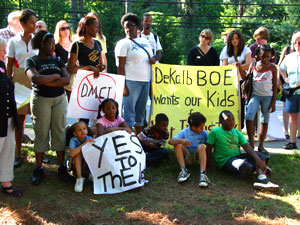 DeKalb County residents protest a proposed U.S Marine Corps academy during a school board meeting at Lakeside High School in Atlanta on June 1. The U.S. Marine Corps is wooing public school districts across the country, expanding a network of military academies that has grown steadily despite criticism that it's a recruiting ploy. AP Wide World Photo/Dorie Turner