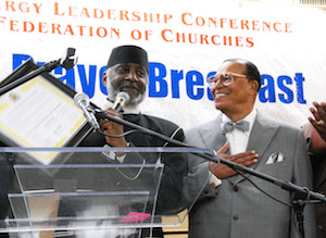 Rev._T.L._Barrett_and_Minister_Louis_Farrakhan.jpg