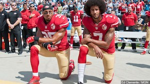 San_Francisco_49ers_Eric_Reid_and_Colin_Kaepernick_take_a_knee_during_the_National_Anthem_prior_to_their_game_against_the_Carolina_Panthers_in_Charlotte_North_Carolina__91816.jpg